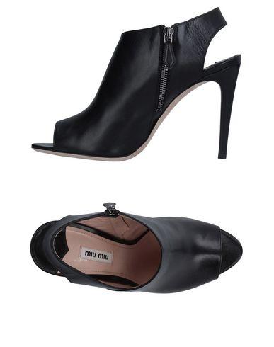 35eac8f14687 MIU MIU · Miu Miu Sandals - Women Miu Miu Sandals online on YOOX United ...