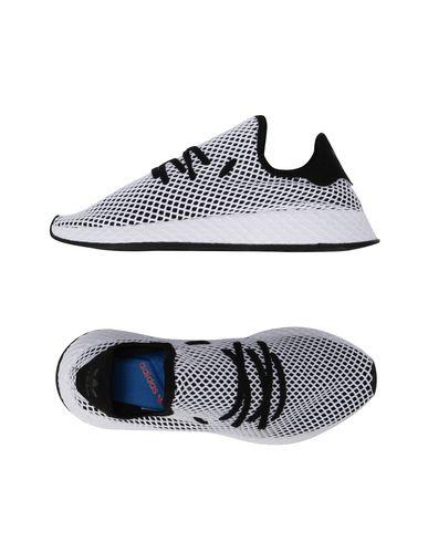 sale retailer 820ee 290a9 ADIDAS ORIGINALS. DEERUPT RUNNER. Sneakers