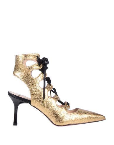 TIPE E TACCHI Sandals in Gold