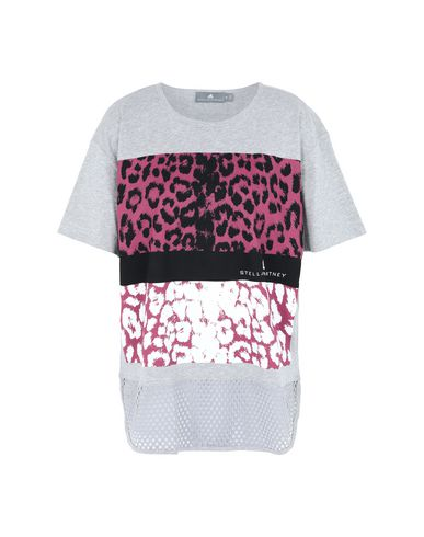 2e64c5d2ea442 ADIDAS by STELLA McCARTNEY. Essentials Leopard Tee. Sports bras and  performance tops