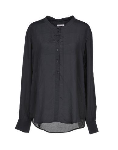 JUST IN CASE Camisas y blusas lisas