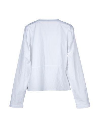 SARA LANZI Camisas y blusas lisas